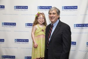 Dr. Marion with a young patient. (Children's Hospital at Montefiore)